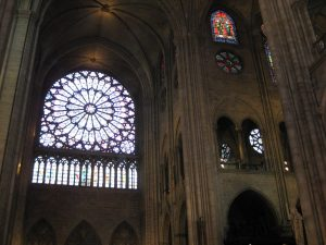 Example of the beautiful stone work, columns, and stained glass in Notre Dame