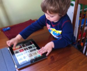 A two and a half year old using an iPad by himself